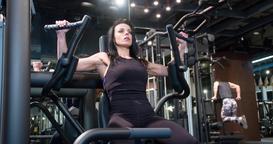 Fitness woman in gym weight training exercise 4k video. Chest workout machine Footage