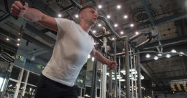 Man in gym doing pulls weight exercise 4k video. Chest training on machine Footage
