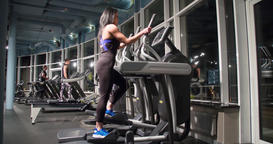 Woman cardio gym 4k video. Fitness girl elliptical exercise machine training Footage