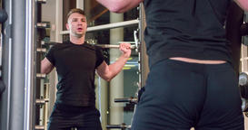 Man smith machine squat exercise with barbell at gym 4k video. Male training Footage