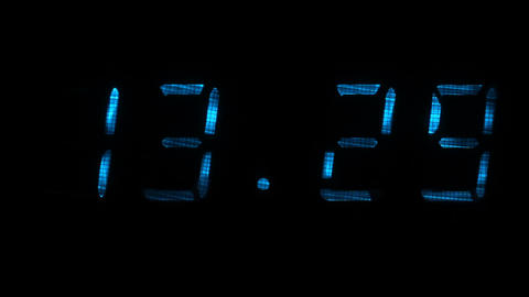 Digital clock shows the time of 13 hours 29 minutes to 13 hours 30 minutes Footage