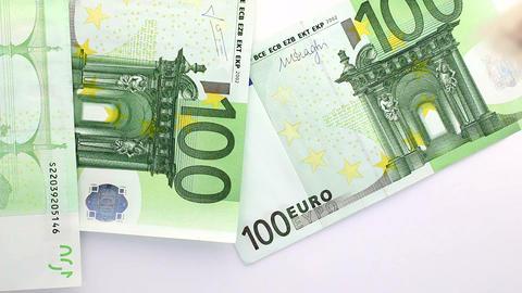 Euro banknotes falling down on white Footage