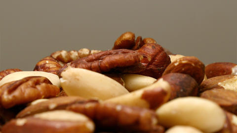 Mixed nuts rotating close up Footage