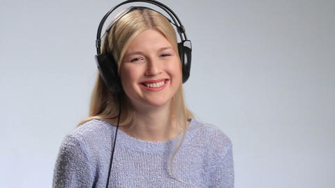 Happy teenage girl in headphones over white Footage