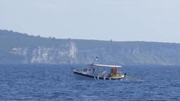 Fishing vessel which gathers nets in which the fish caught during the night floa Live Action
