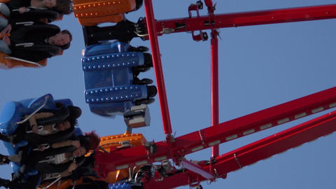 Young people on a funfair ride Stock Video Footage