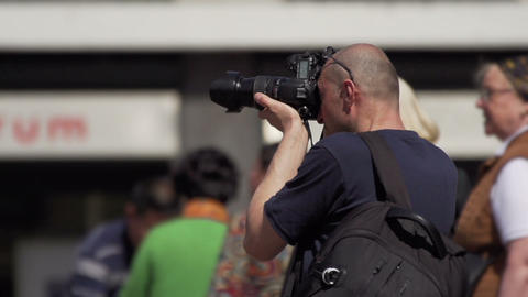 Photographer takes pictures in the city Stock Video Footage