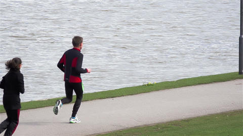 Jogging by the river Stock Video Footage