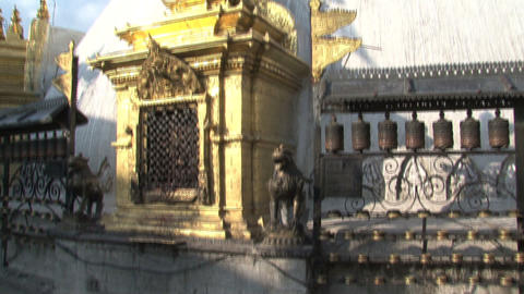 Tilt from the prayer wheel to the Swayambhunath st Stock Video Footage