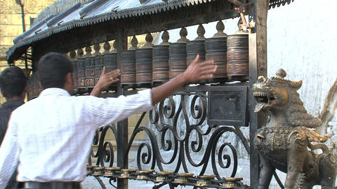 Two guys spinning the prayer wheels Stock Video Footage