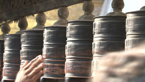 Hands touching the prayer wheels Footage