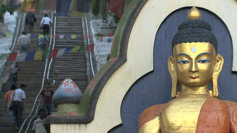 Entrance with buddha and stair to the Swayambhunat Stock Video Footage