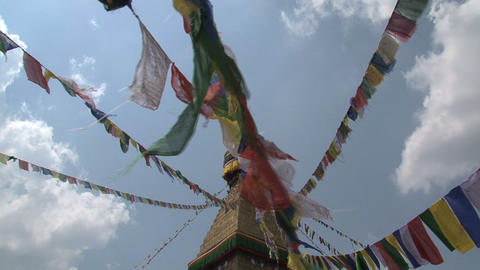 Prayer flags in the wind reaching the top of the B Footage