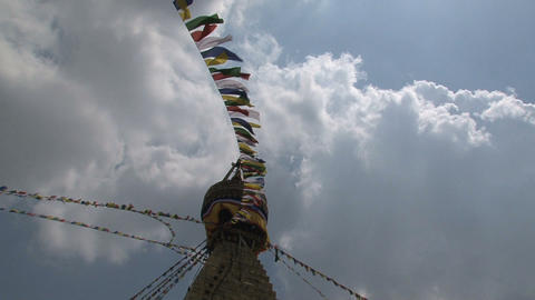 Prayer flags in the wind reaching the top Footage