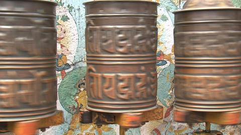 Three prayer wheels spinning Stock Video Footage