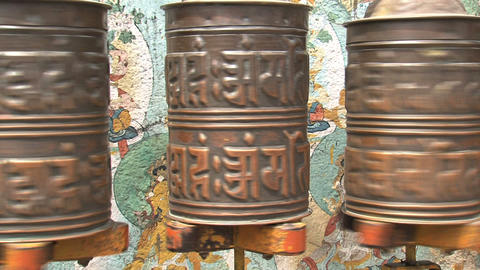 Three prayer wheels spinning Live Action