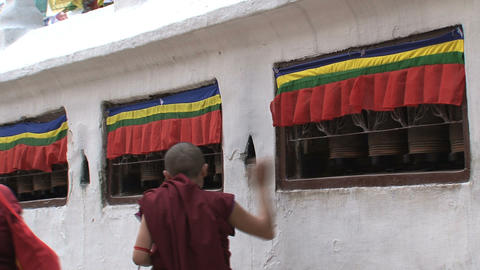 Monk spinning the prayer wheels Footage