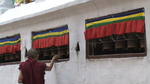 Monk spinning the prayer wheels Stock Video Footage