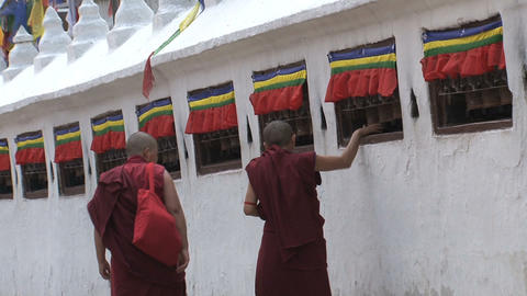 Monks walking while spinning the prayer wheels Footage