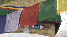 Prayer flags in front of the Boudha stupa Stock Video Footage