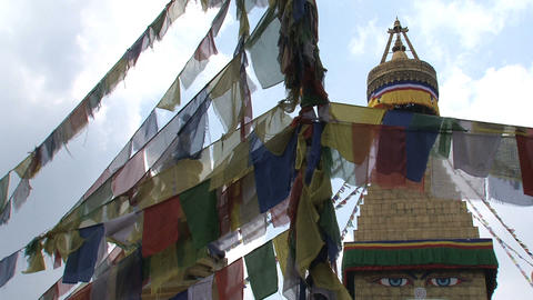 Prayer flags with the Boudhanath Stupa Stock Video Footage