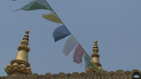 Golden rooftop with prayer flags Stock Video Footage
