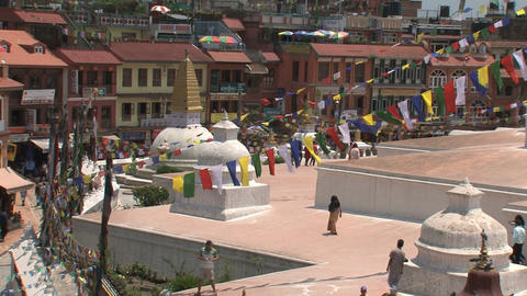 People walking at the Boudha stupa Stock Video Footage