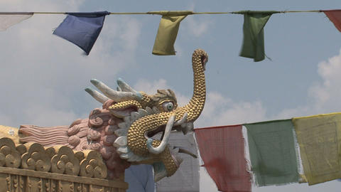 Close up from a dragonhead with prayer flags Stock Video Footage
