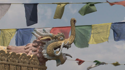 Close up from a dragonhead with prayer flags Footage