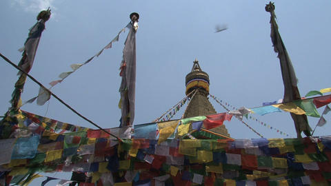 Prayer flags in front of the Boudha stupa Footage