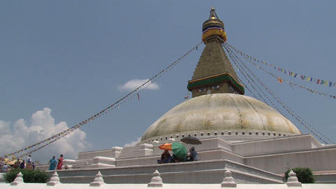 People walking around the Boudha stupa Stock Video Footage