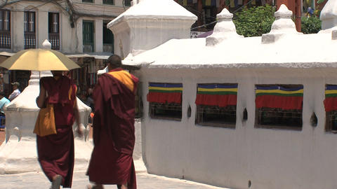 Monks walking around the Boudha stupa Stock Video Footage