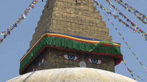 Eyes of the Boudha stupa in Kathmandu Stock Video Footage