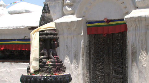 Statue with scarf at the Boudhanath stupa Stock Video Footage