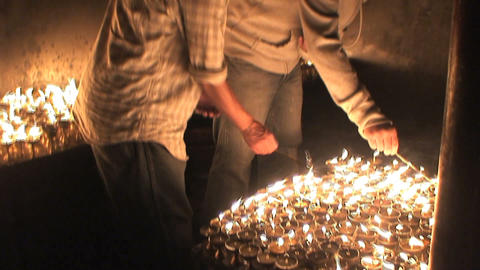 Two guys turn on candles during Buddha's birthday Stock Video Footage