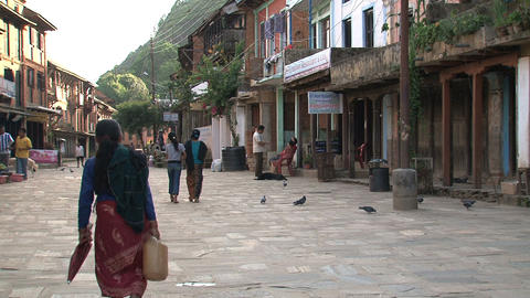 People walking down the street in Bandipur Footage