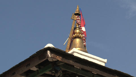 Rooftop of a temple in Bandipur with the flag of n Footage