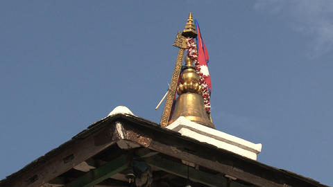 Rooftop of a temple in Bandipur with the flag of n Stock Video Footage
