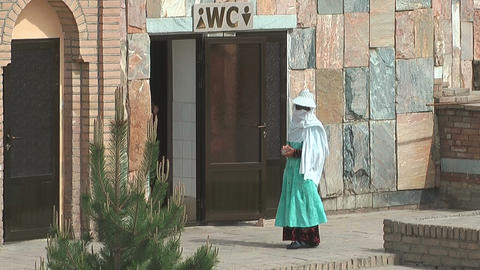 uzbekistan lavatory attendant waiting for customers Stock Video Footage