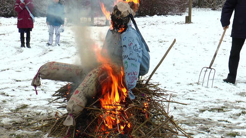 Burning a straw doll on a funeral pyre for driving out the winter Footage