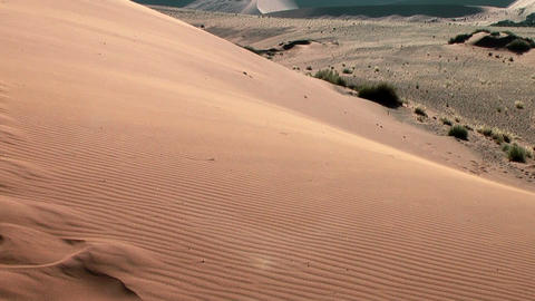 sand floating over big daddy dune Stock Video Footage