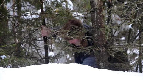 Forestry worker with an ax that cuts a tree in the forest covered by snow 30 Live Action