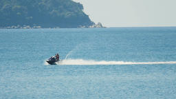 Man on jetski rides on ocean surface and filming Footage