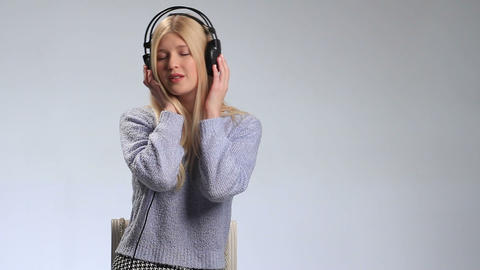 Dreamy teenage girl with headphones singing song Footage