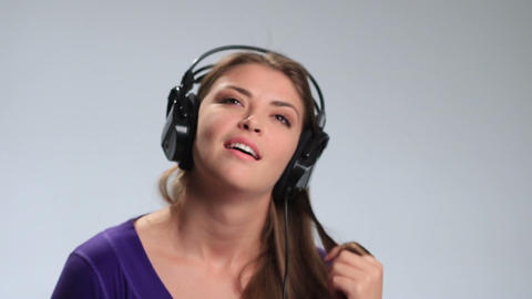 Cute girl relaxing listening music with headphones Live Action