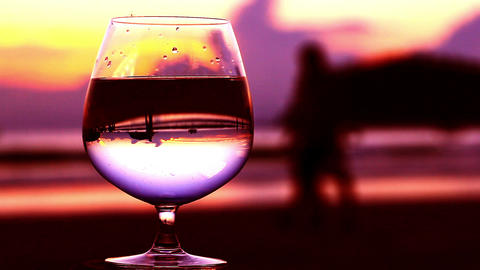 A glass of water on the beach Footage