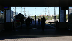 Passengers hurry to shuttle train, black silhouettes run at passage to platform Footage