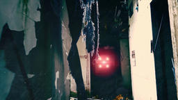 Camera moves through gloomy corridor of dilapidated building towards bright flas Footage