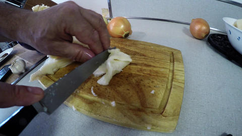 CLOSE-UP OF MAN CUTTING BEEF TRIPE Footage