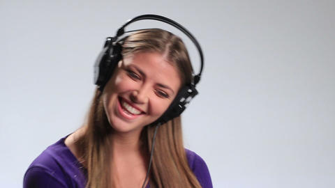 Excited brunette girl in headphones enjoying music Footage